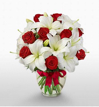 Ardahan hediye çiçek yolla  1 dal kazablanka 11 adet kırmızı gül vazosu